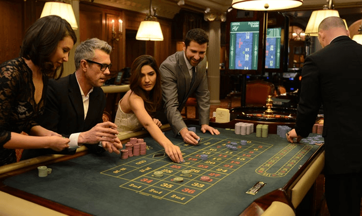 A group of people playing roulette at the Les Ambassadeurs casino in Mayfair, London.