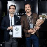 Swedish slot developer ELK Studios team members holding their award for the Sweden Fast 50 listing.