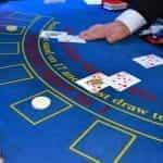 A dealer revealing cards in a game of blackjack.
