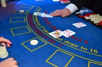 A dealer revealing cards in a game of blackjack.