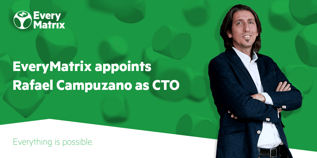"Rafael Campuzano standing next to a banner that reads ""EveryMatrix appoints Rafael Campuzano as CTO."