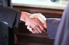 Hands shaking over a successful business deal.