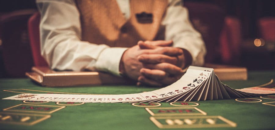 A man sits at a poker table.