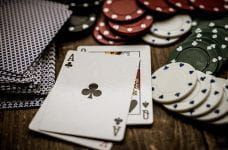 Playing cards and poker chips on a table.