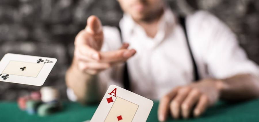 A man flicking a card towards the camera.
