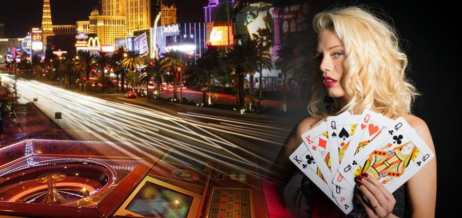 A street lined with the bright lights of casinos.