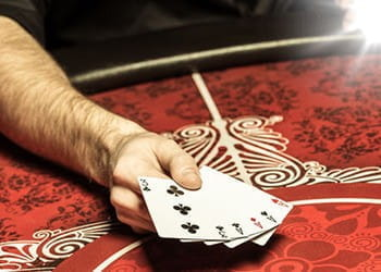 A hand of cards of a table.