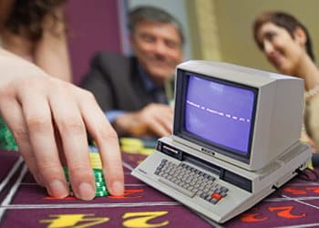 A computer at a poker table.