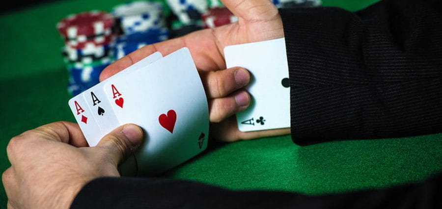 A playing card up a sleeve.