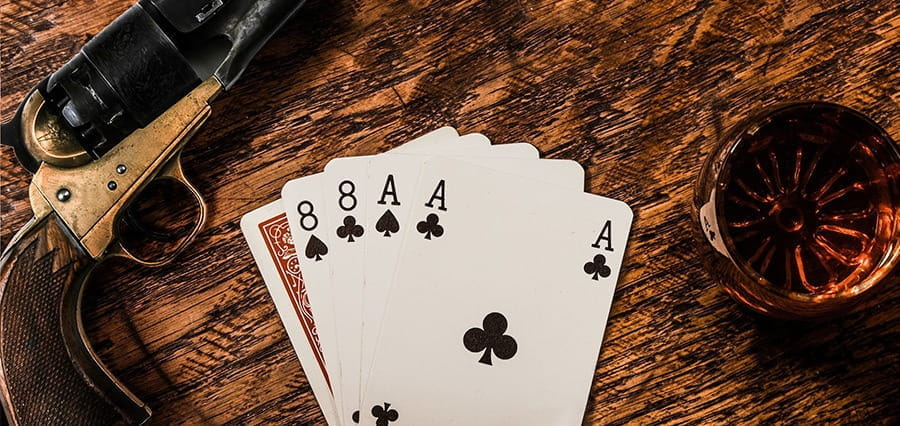 """A """"Dead Man's Hand"""" in poker on a table."""