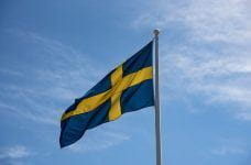 The Swedish flag blowing in the wind.