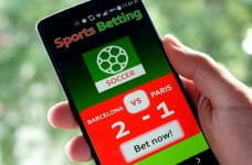 A mobile phone with sports betting on the screen.