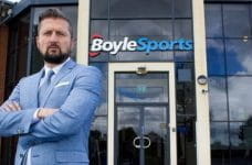 CEO Conor Gray in front of a BoyleSports shop.
