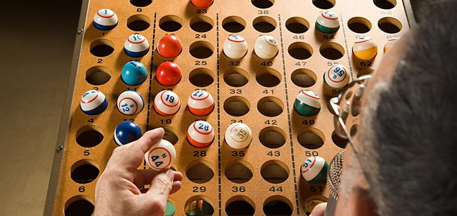 A bingo caller with bingo balls.