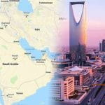 Saudi Arabia on a map next to a cityscape.