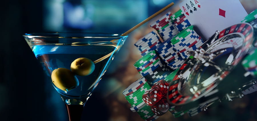 A martini, playing cards, casino chips and a roulette wheel.