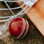 Cricket ball, bat and helmet.