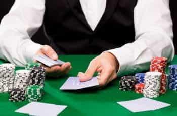 A casino croupier dealing cards.