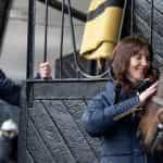 Debbie Matthews petting a horse.