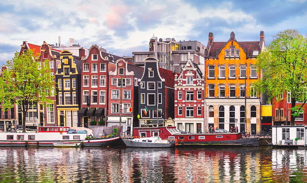 A row of houses in Amsterdam, seen over a canal.
