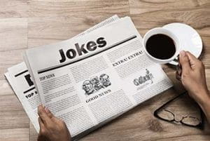 "A newspaper with the headline ""Jokes""."