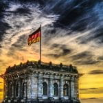 A German flag atop the Reichstag building in Berlin.