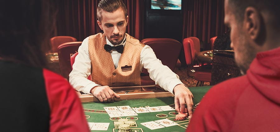 A croupier dealing cards in a casino.