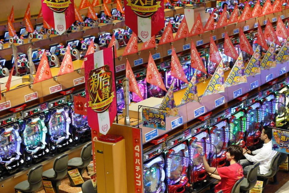 A line of pachinko machines in a parlor.