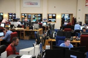Employees sit at desks, looking at computers, in Betfred's offices.