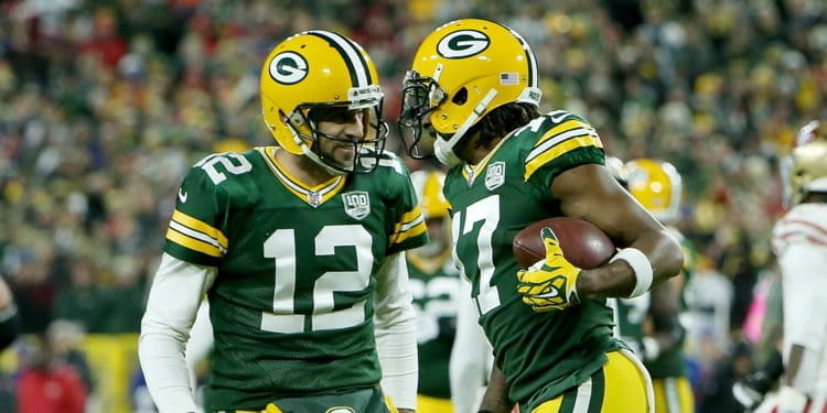 Two members of the Green Bay Packers in the middle of the game.