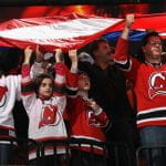 New Jersey Devils fans holding up a flag.