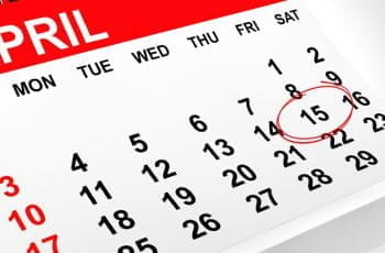 A calendar with Friday April 15th circled.