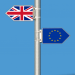 The Union Flag and the European Union Flag as sign posts, pointing in opposite directions.