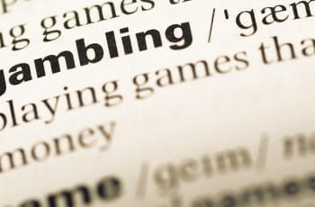 """The word """"gambling"""" and its definition in a dictionary."""