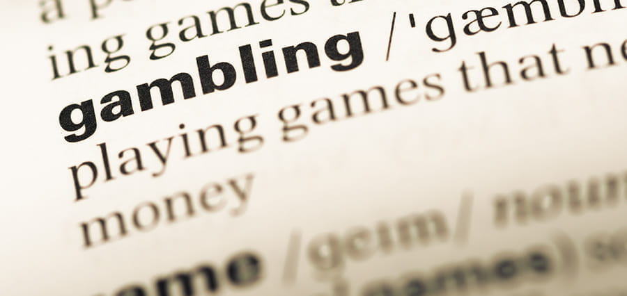 "The word ""gambling"" and its definition in a dictionary."