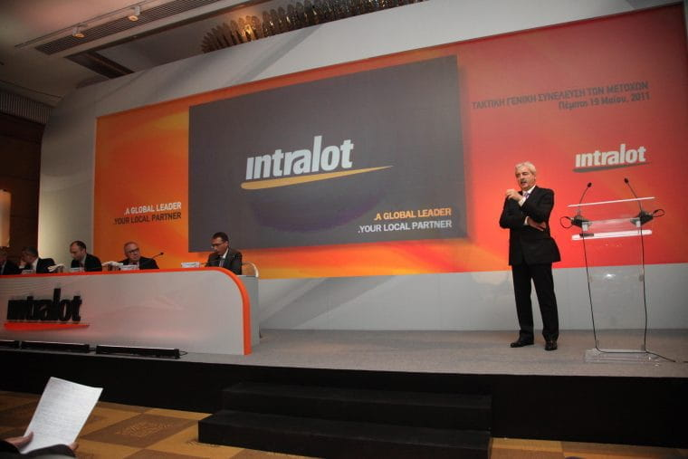 Speakers on stage at an Intralot event.