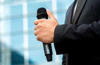 A man holding a microphone.
