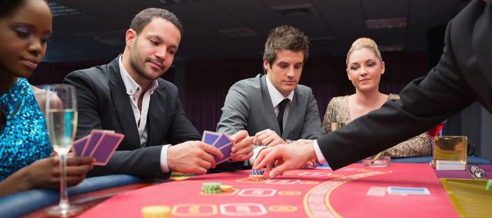 A game of poker, with four players sitting at the table.