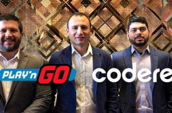 Executives from Play'n GO and Codere smile with both logos positioned in front of them.