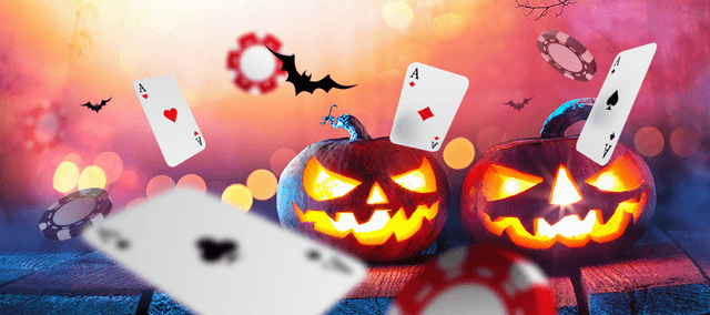 Two Halloween pumpkins surrounded by bats, playing cards and casino chips.