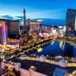 The Las Vegas Strip casinos illuminated at dusk.