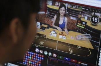 A user gambles on an online site offered through a company in the Philippines.