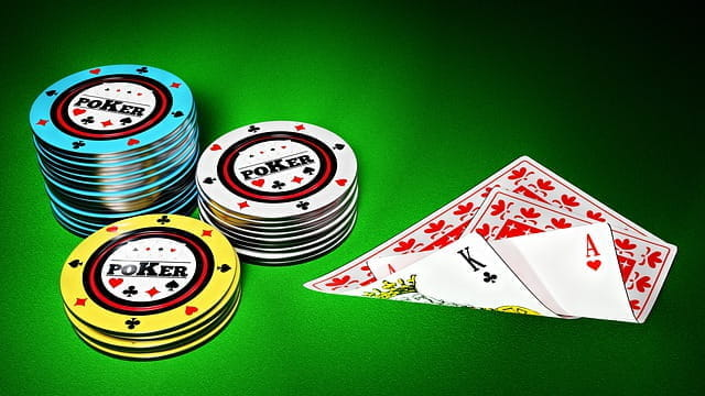 Drawing of poker cards and chips on green background.