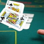 A player throws to King Cards down on to a Poker table.