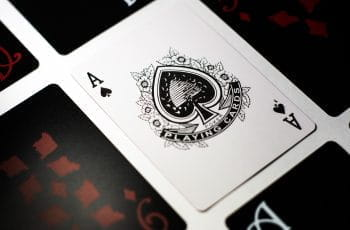 An Ace of Spades appears face up amidst face down cards.