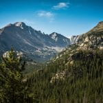 The Colorado natural landscape dotted with mountains and pine trees.