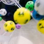 Colorful lottery balls bounce around a spinner.