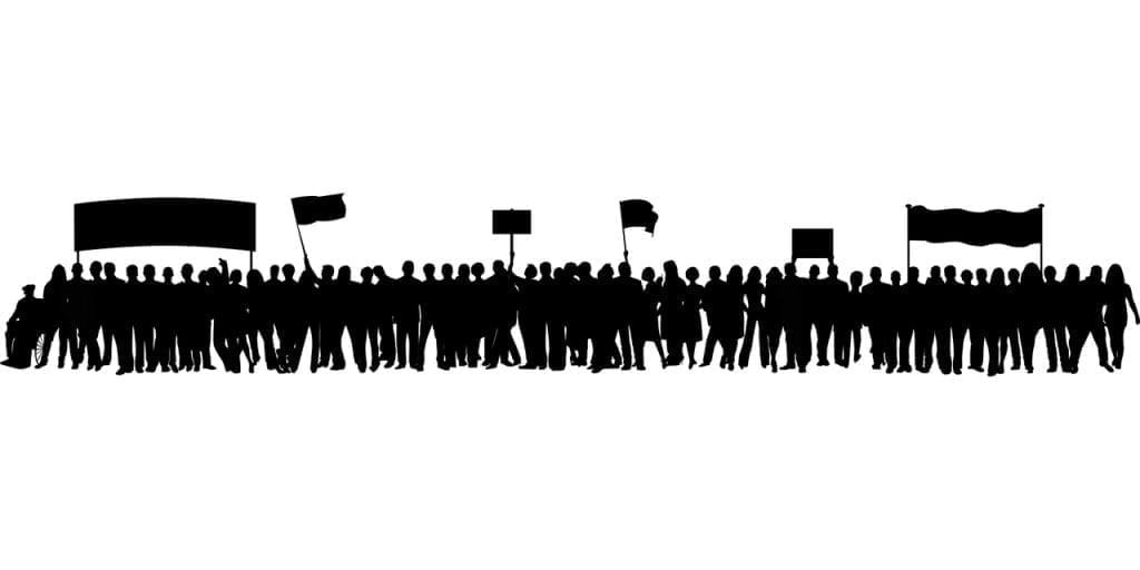 A black silhouette of a crowd protesting.