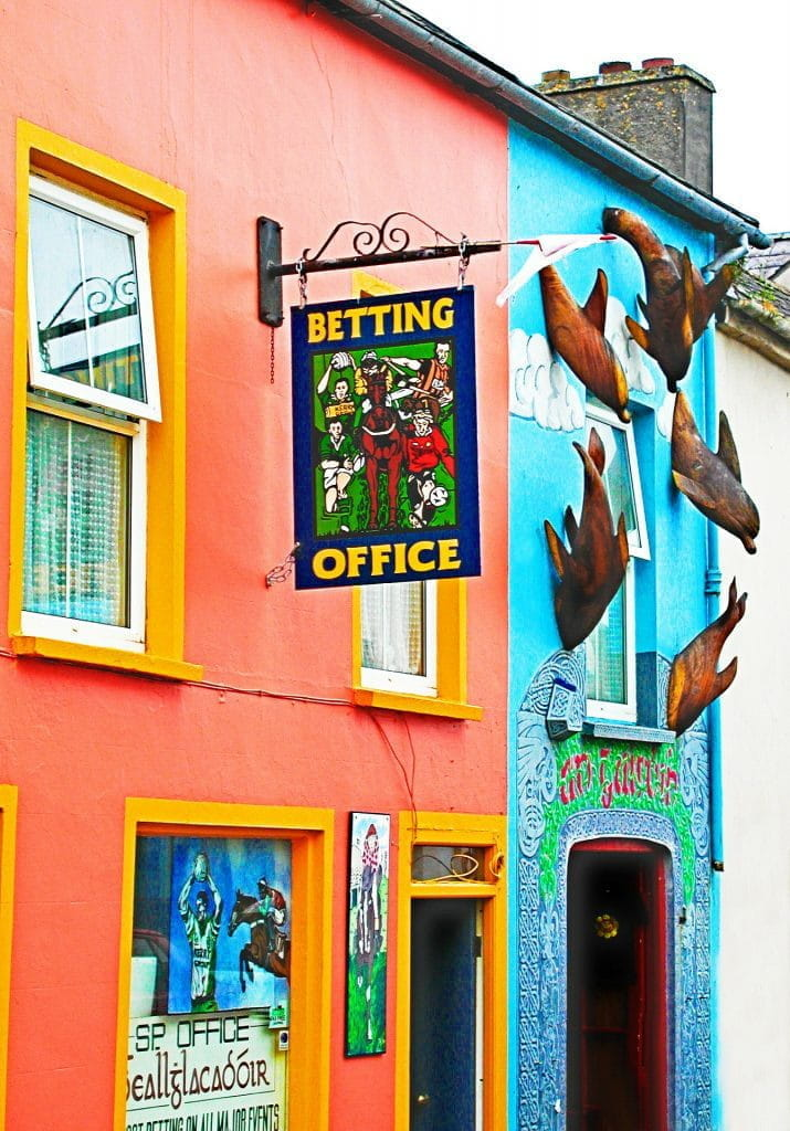 "A building with a ""betting office"" sign outside."