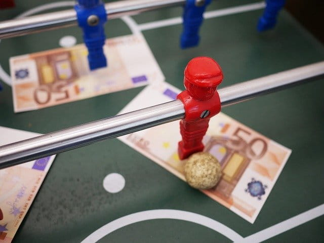 Table football and bank notes.
